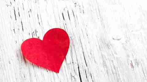 A red heart on a white background represents the love of an adult with ADHD