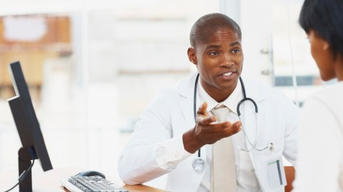 A doctor discussing with a patient about healing her ADHD