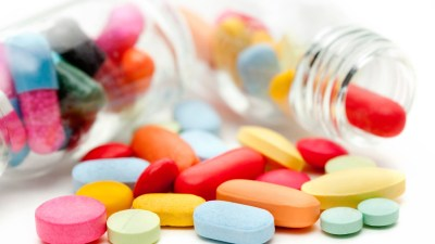 A pile of ADHD medications, many of which have possible side effects