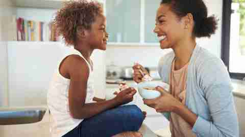 Mother and daughter eating breakfast and discussing the side effects of her ADHD medication