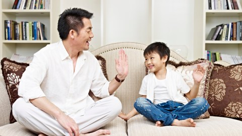 Father and son sitting on couch and discussing the side effects of his ADHD medication