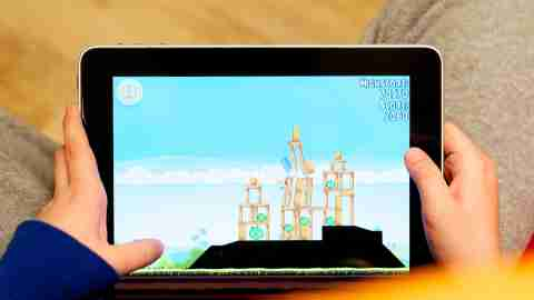 A tablet screen with a game, child spending time playing online game