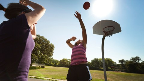 Child punching a basketball after her parents limited her screen time