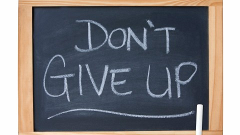 """Don't give up"" on a chalkboard at a parent-teacher conference"