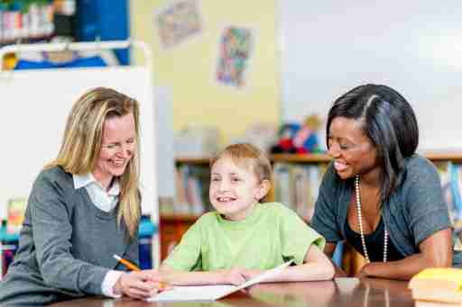 Parent and teacher having a conference to discuss a student