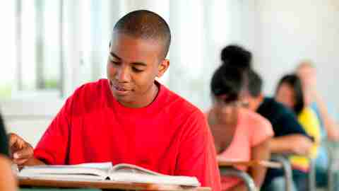 A student reading in class who would benefit from assistive technology.