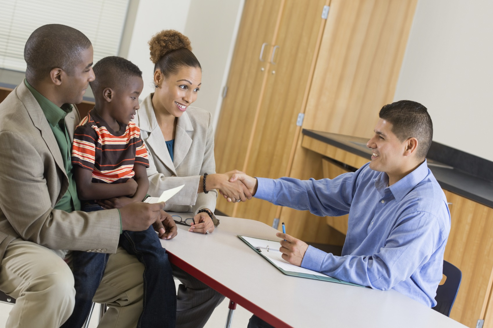 Teacher working with parents on medication monitoring