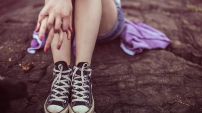 A teenage girl with ADHD feels ashamed about her symptoms and sits quietly alone