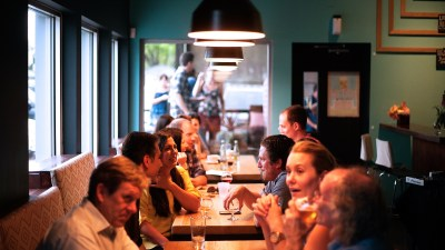 People in conversation in a restaurant may not understand what it feels like to have ADHD.