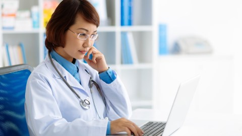 Doctor looking up information on ADHD to better answer questions