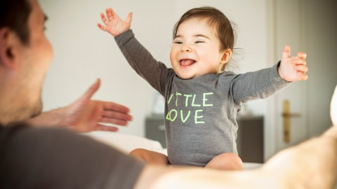 A smiling baby has a language processing disorder