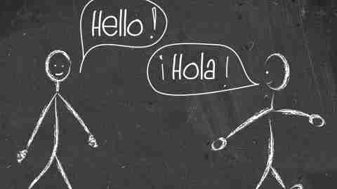 Two stick figures speak Spanish. Learning a foreign language can be difficult for people with language processing disorders.