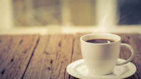 A coffee cup on a table, a tool celebrities with ADHD use to harness energy for success