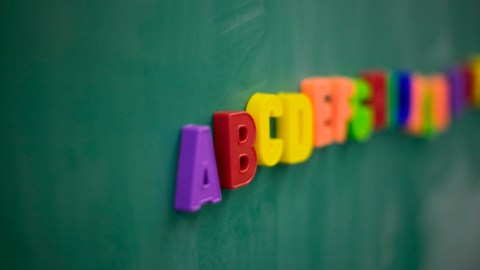 Magnetic letters on a chalkboard, the use of which could improve the education system for kids with ADHD