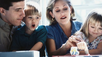 Family playing a board game after school to help kids manage anxiety