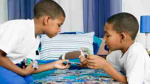 Kids playing a card game with a reward system