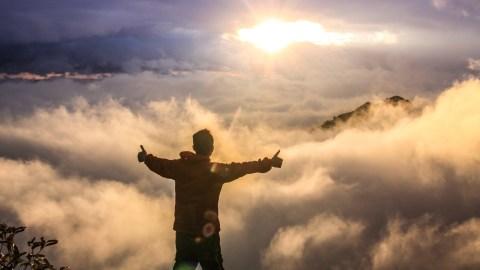 A man with SPD climbs a mountain