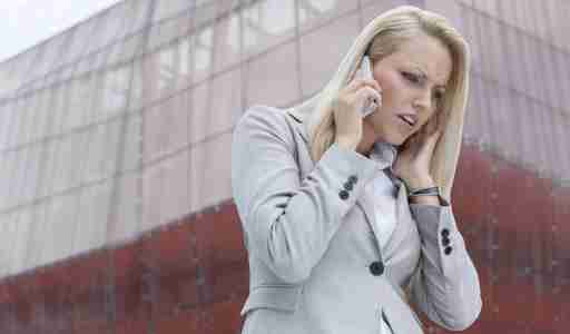 Woman with ADHD having trouble hearing someone on cell phone