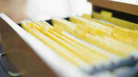 Open drawer filled with yellow files in organized home