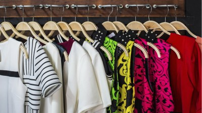 Different blouses on hangers in closet belonging to ADHD woman