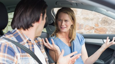 Man arguing with woman with ADHD in car
