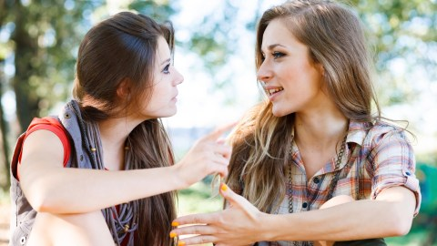 Two girls with ADHD have a conversation outside.