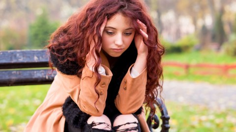 A girl with undiagnosed adhd sits and wonders what is wrong with her.
