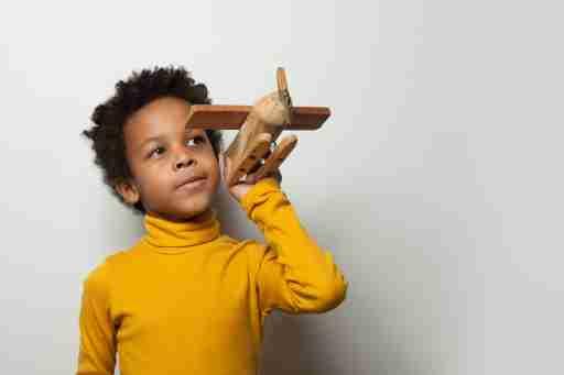 African American Preschooler with toy plane