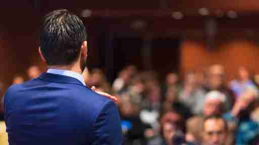 A man at a podium experiencing public speaking anxiety