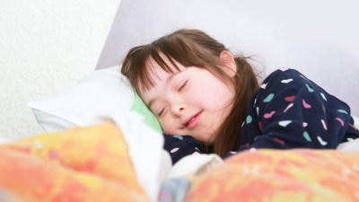 A child with sensory issues sleeping in warm pajamas