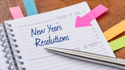 Daily planner with the entry New Years Resolutions belonging to someone with ADHD