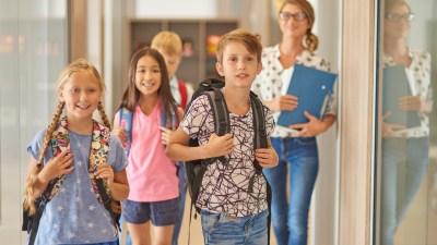 ADHD Pupils and teacher walking across the corridor