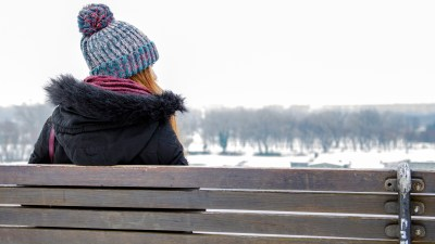 ADHD woman sitting on a bench in winter