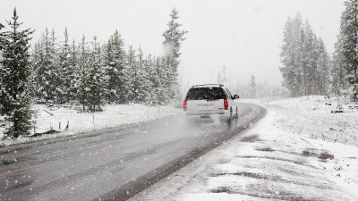 A man driving with ADHD uses hyperfocus to navigate a blizzard.