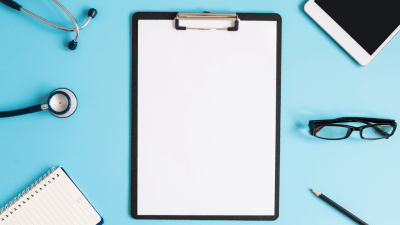 clipboard with paper, stethoscope, pen, glasses--tools to make a sound ADHD diagnosis
