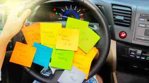Post-its on a car steering wheel representing time management stress