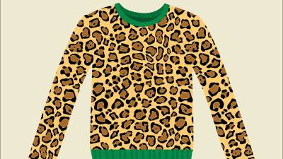 A leopard print sweater with green trim, made by someone with ADHD who has problems following directions