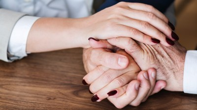 A woman and a man hold hands while talking about ADD and relationships.