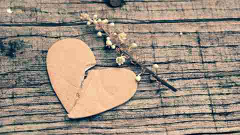 A broken heart on a wooden background