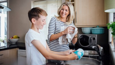 A mother with ADHD helps her ADD child get organized and do the dishes