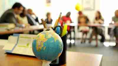 Detail of a globe in a room where an IEP meeting is happening