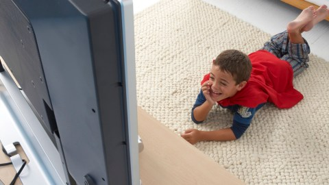 A boy with ADHD watches TV