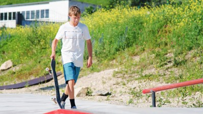 A teenager with ADHD in a skate park, thinking about taking responsibility for his actions