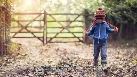 Boy walking in mud