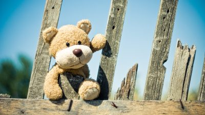 Teddy bear on a fence representing a lonely child with ADHD