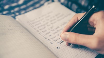 An adult with ADHD writes a daily to do list.