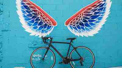 Graffiti of wings over a bicycle to represent autism or learning disabilities