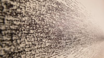 Scribbles on a wall signifying the many hard-to-read signs of autism in adults