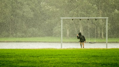 Boy swinging in the rain representing the isolation felt by many with ADHD
