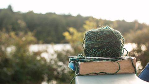 knitting and a book representing self care as a relationship goal for adhd marriages
